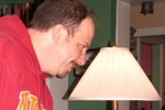Mike Capilo and the lamp having a staring contest.